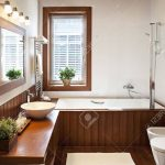 contemporary residential home bathroom interior in sunlight