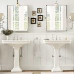 country style bathroom with pedestal sinks installing small