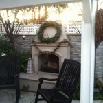 courtyard fireplace home is where the heart is