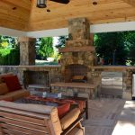 covered outdoor kitchen with fireplace cileather home