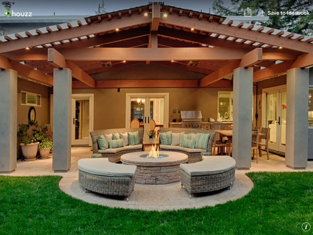 covered patio part roof part pegola with a fire pit
