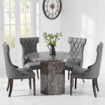 crema grey round marble dining table with freya chairs