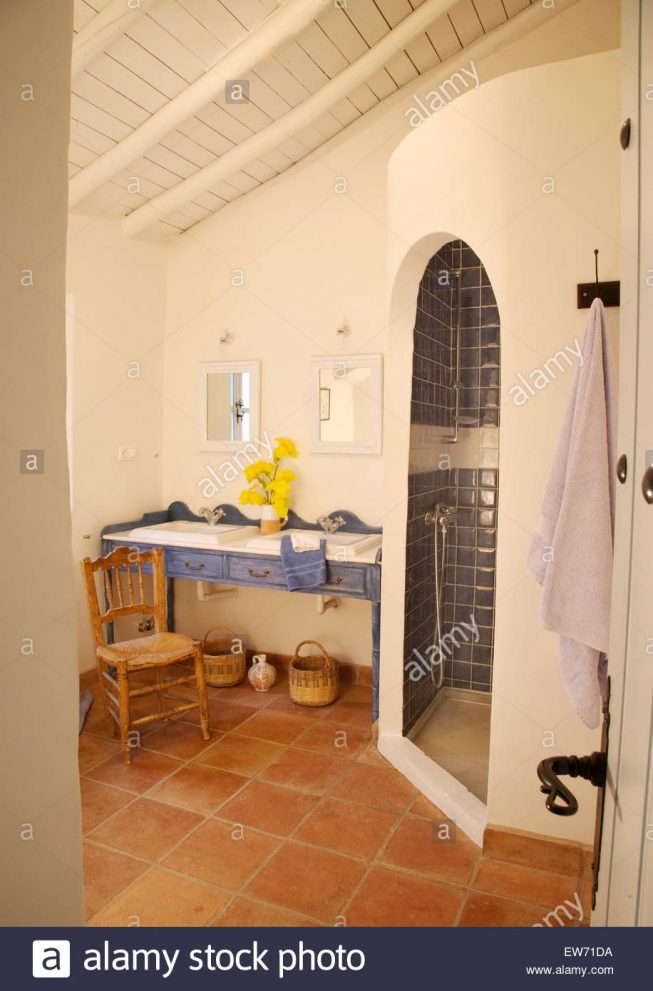 curved adobe style shower in rustic spanish bathroom with