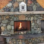 custom built river rock fireplace backyard fireplace