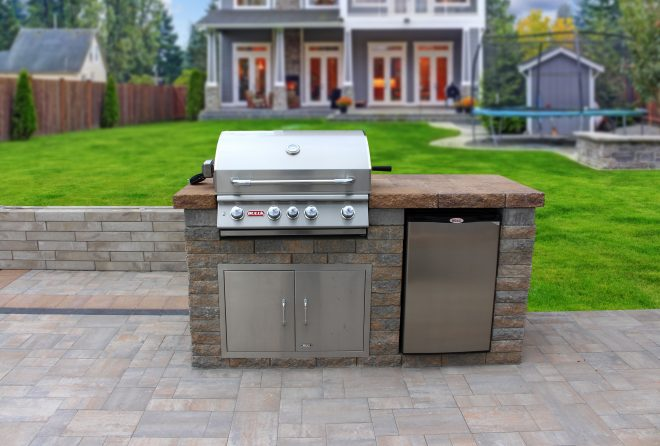custom outdoor kitchen island with stone countertop and bull