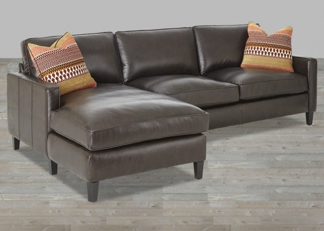 dark brown leather sectional with accent pillow