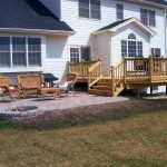 deck and patio design with built in fire pit in hawthorn