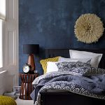 deep blue accent wall in modern eclectic bedroom gorgeous