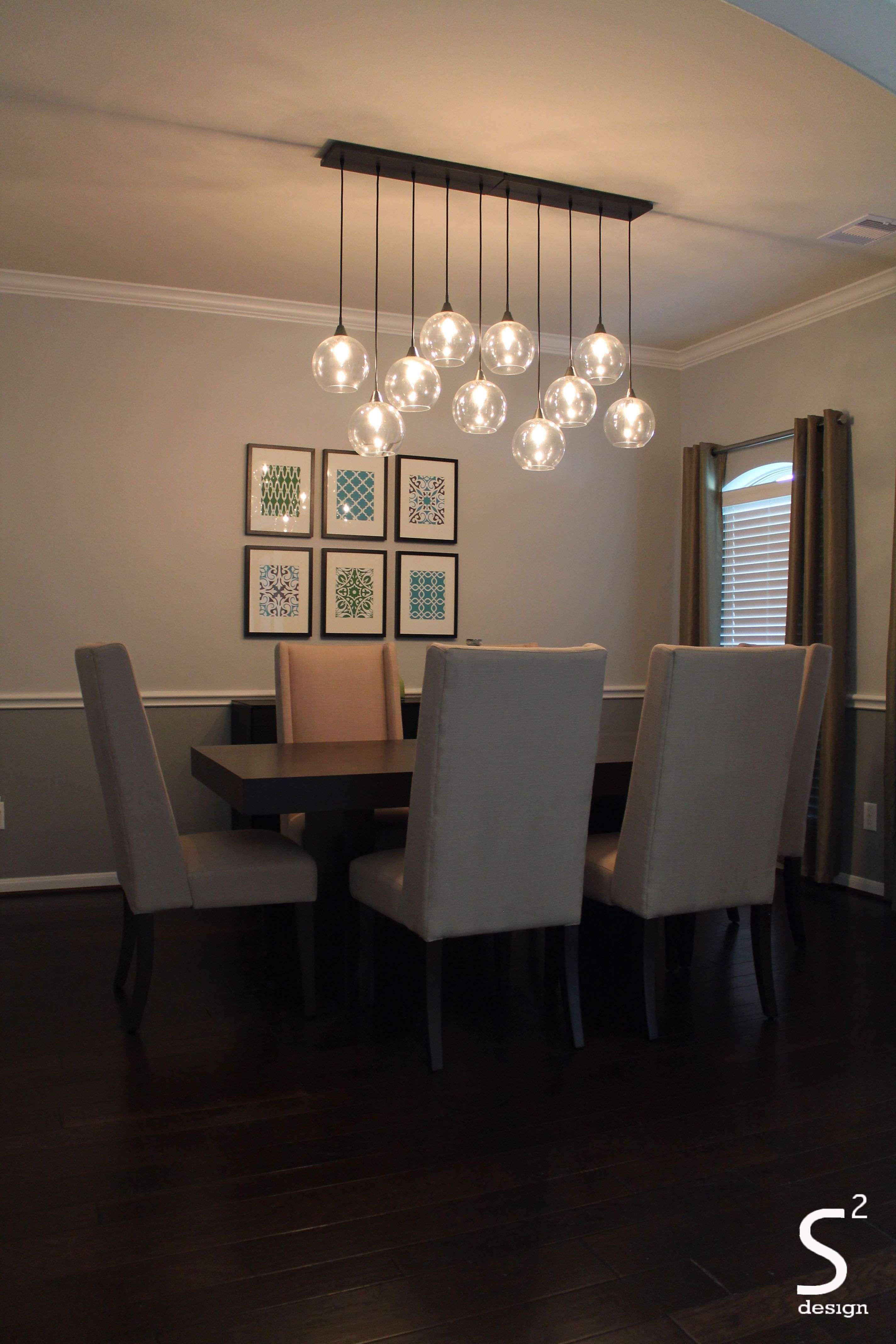 dining room green curtains blue glass chandelier high back dining