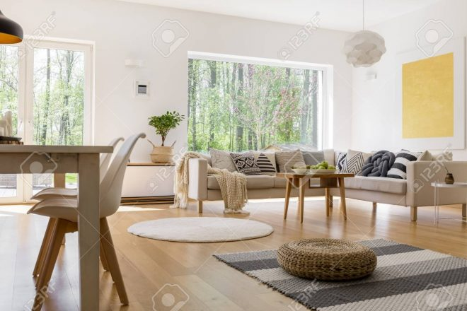 dining table with designed white chairs in multifunctional living