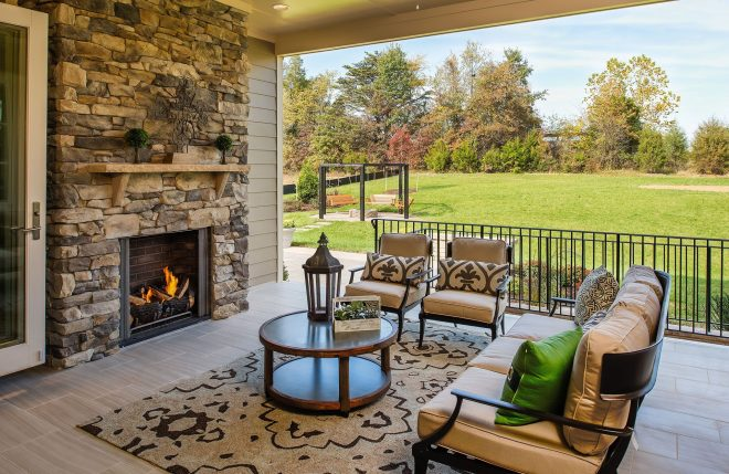 drees homes covered porch with fireplace opens right into
