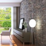 elegant living room with an exposed brick wall