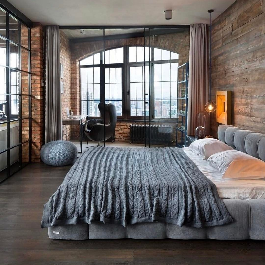 exposed brick bedroom with private glasses in workspace the