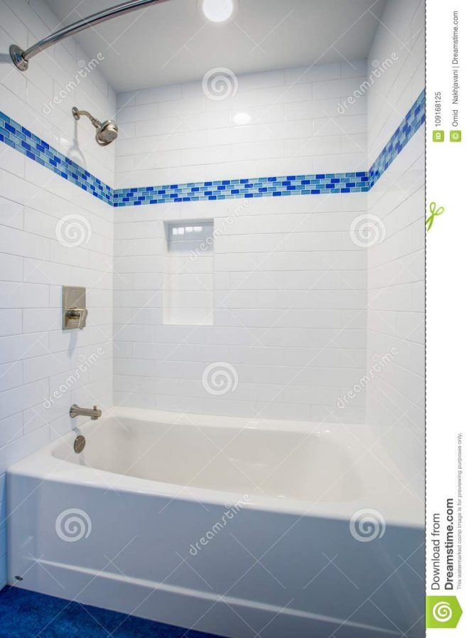 fantastic bathroom with a drop in tub and shower combo stock