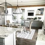 farmhouse style open layout with kitchen dining room and