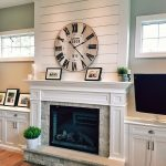 fireplace with lower bookshelves and windows above fireplace wall