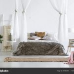 fur coverlet placed king size bed cushions canopy white