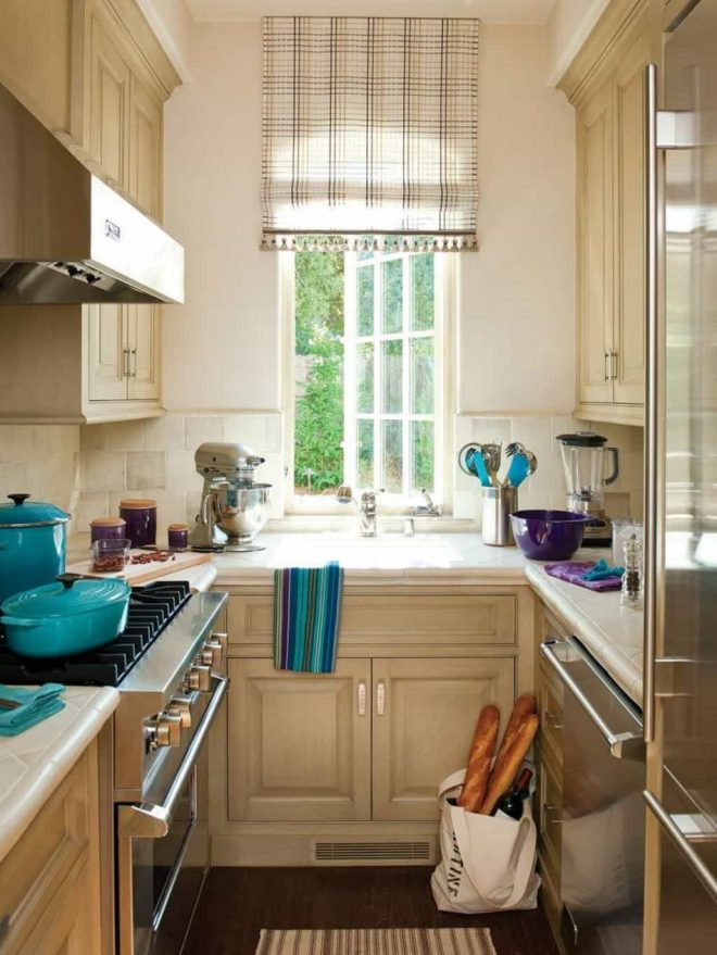 galley kitchen with cabinets and window blind countertop space