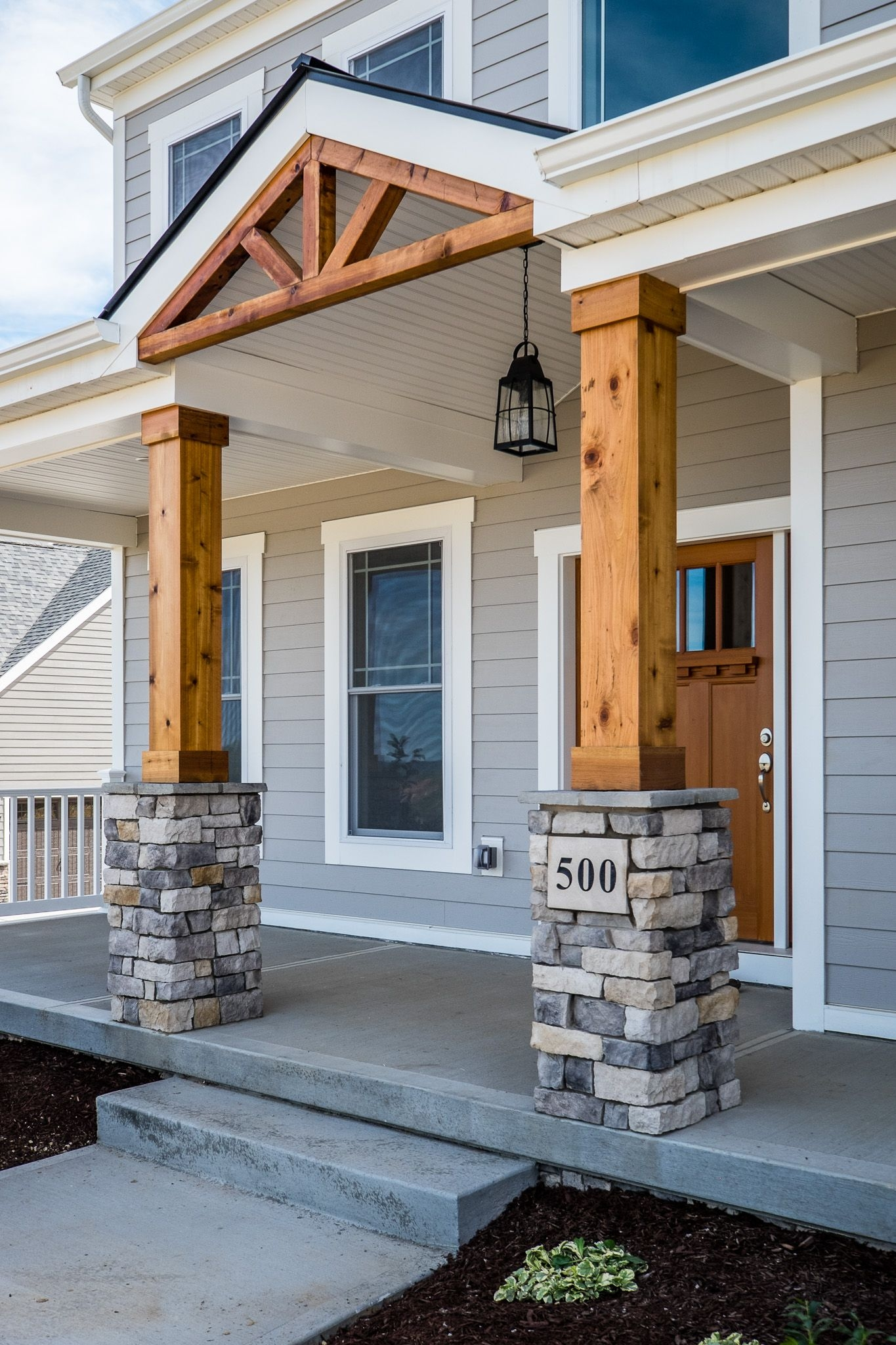 gorgeous front porch wood and stone columns build again someday
