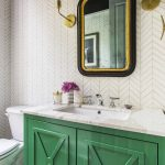 gorgeous transitional bathroom decor with green vanity and