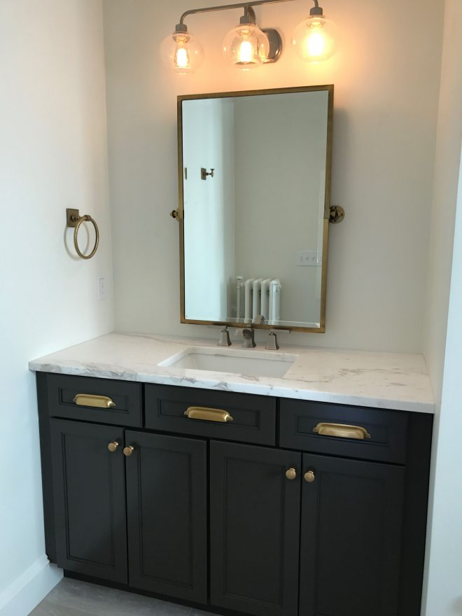 gray bathroom vanity with brass hardware real homes