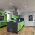green kitchen with kitchen island in the attic room with wood