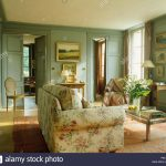 green sofa in traditional country stock photos green sofa