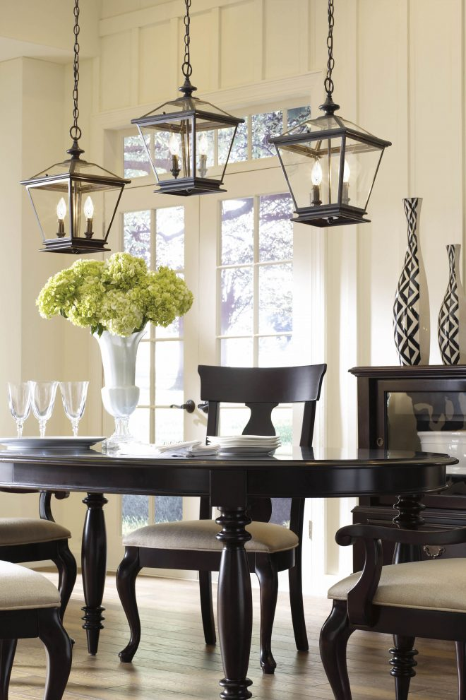 grouped lanterns above a dining room table add a