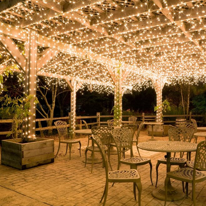 hang white icicle lights to create magical outdoor lighting