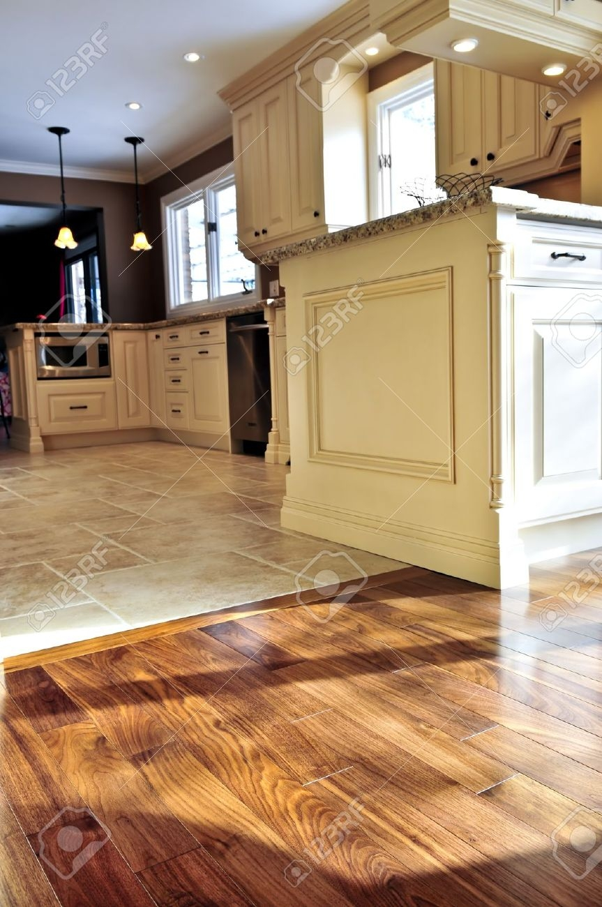 hardwood and tile floor in residential home kitchen and dining