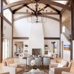 high ceilinged great room with dark wood exposed beams and