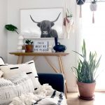 highland cow print black and white boho living room