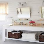 horizontal plank walls in the bathroom lend a cottage feel