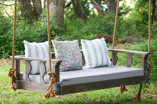 how does a bed swing differ from a traditional porch swing