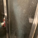 how to remove the scum from this shower door we have tried