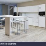 in a modern office floor there is a beautiful office kitchen