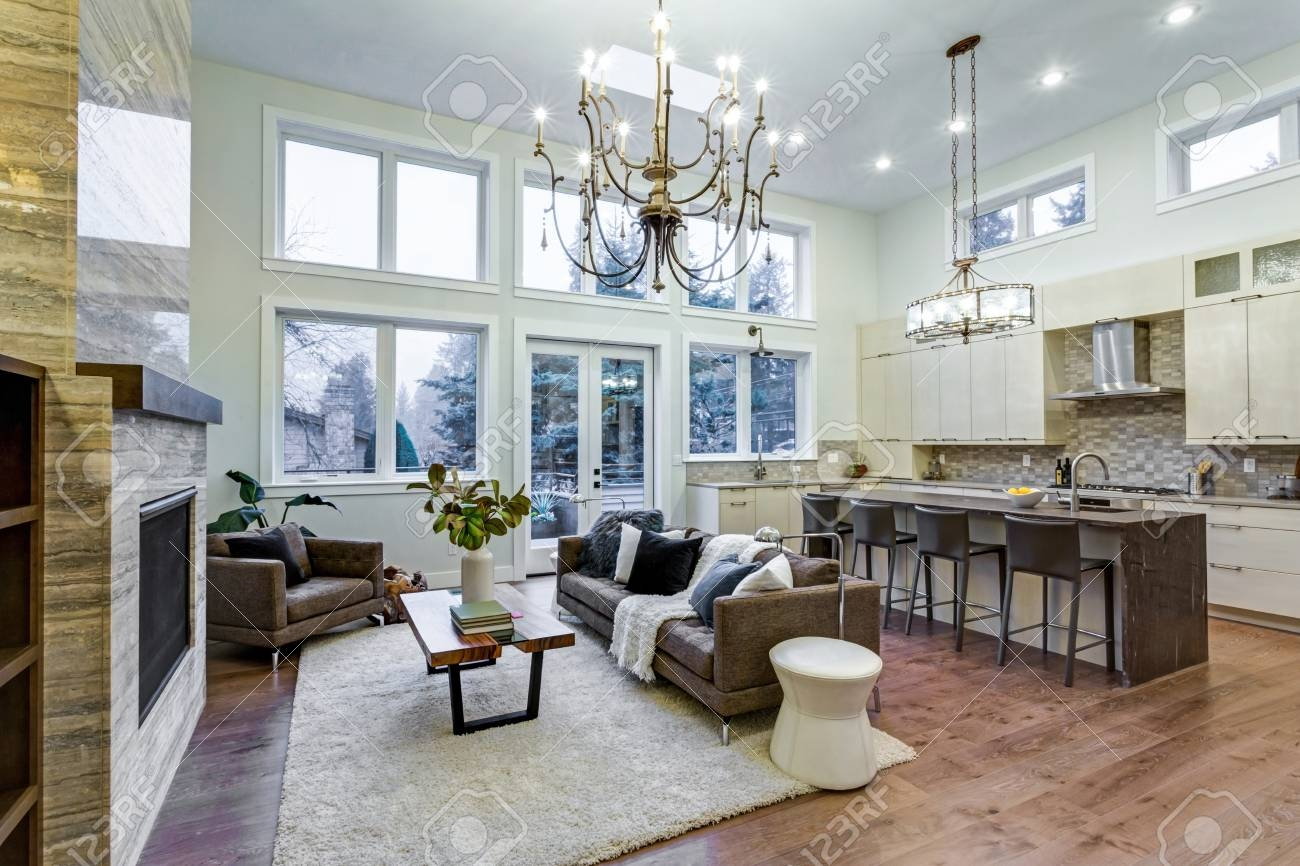 incredible light and airy living room with high ceiling stone