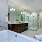 incredible master bathroom with fireplace carrara marble tile