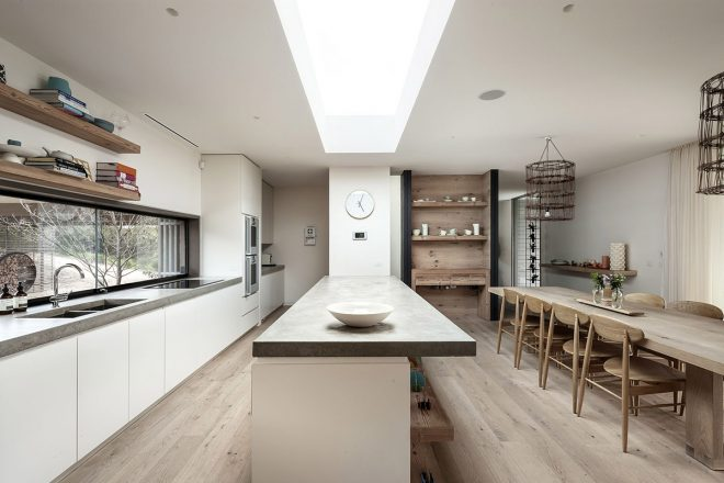 interesting long narrow kitchen with long old wooden dining table