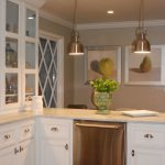 kitchen love the cream countertops against the white cabinets and