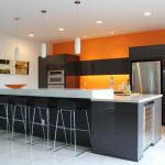 kitchen orange wall color ideas with black island and