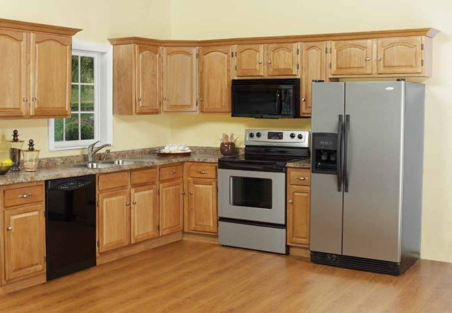 kitchen remodel with oak cabinets and hardwood floors wow