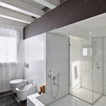 large bathtub and glass shower cubicle in a modern bathroom with