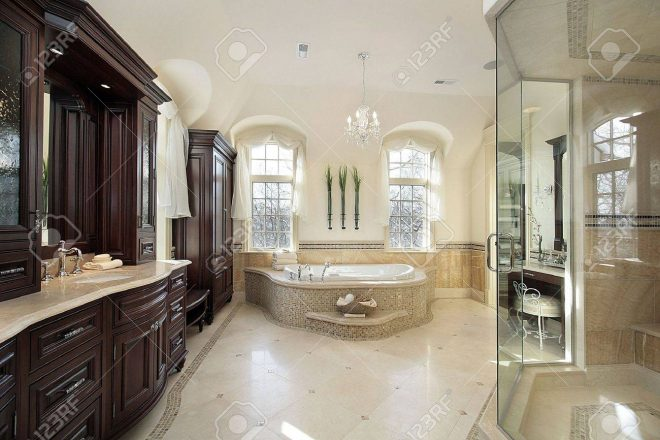 large master bath in luxury home with glass shower