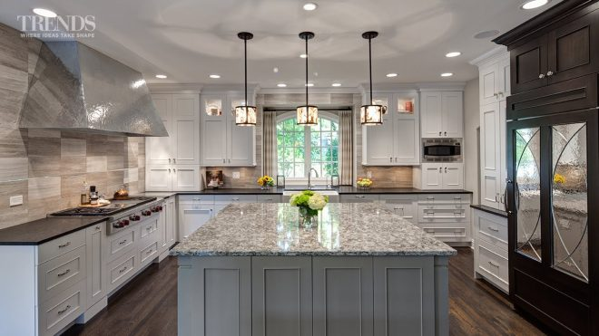 large transitional kitchen design has two islands and a mix of white