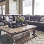 leather sofa with throw pillows rug country living room