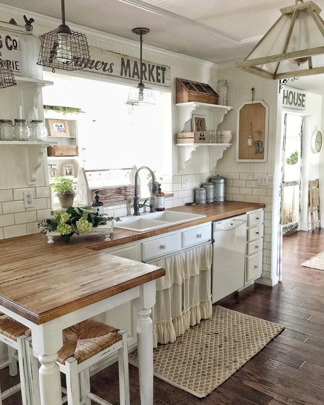 like the butcher block with darker floors white cabinets white