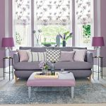 lilac living room with grey toned sofa and floral blinds decor