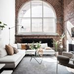 living room interior design exposed brick wall big grid window