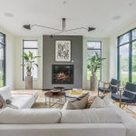 living room with fireplace and floor to ceiling windows